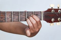 Play the guitar by hand version 8 Stock Photo