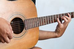Play the guitar by hand version 9 royalty free stock image