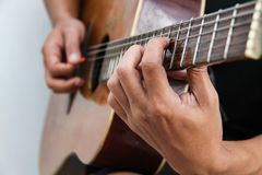 Play the guitar by hand version 11 Stock Photo