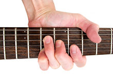 Play guitar music. Hand playing musical instrument guitar frets and finger chord white isolated background Stock Photos