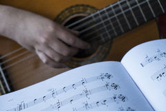 Play a  guitar Royalty Free Stock Photography