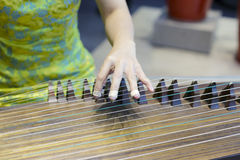 Play the guqin Royalty Free Stock Image