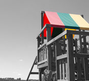 Play House. A wooden play house for children.  A black and white photo with certain things in color Stock Images
