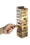 Play jenga. Close-up hand play jenga on white background Stock Photography