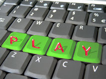 Play on a keyboard. Play word on a notebook keyboard Stock Photography