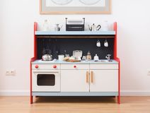 Play kitchen and toy kitchenware for children. Making dough for Stock Images