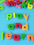 Play & learn. Children's puzzle: play and learn words, closeup Royalty Free Stock Images