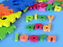 Play and learn. Words made with foam puzzle: play and learn Royalty Free Stock Photo
