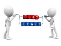 Play and learn. Play way to learn concept, little white men holding up chrome apparatus which has word blocks arranged in them reading play and learn, white Royalty Free Stock Photos