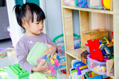 Play and learn. Little girl play and learn Royalty Free Stock Photography