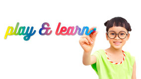 Play and learn. Little girl writing play and learn word in the air stock photography
