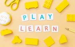 Play Learn with toy and objects for child education concept on yellow royalty free stock photography