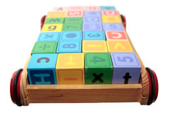 Play letter blocks in cart with clip path Royalty Free Stock Images