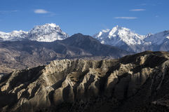 Play of light on the mountains of Upper Mustang. Light and shadow on the altitude deserts, high mountains and sandstone towers. Himalaya Stock Image