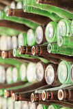 Play of light, reflection and transparency on a wall of bottles. Play of light, reflection and transparency on a wall of empty beer bottles Royalty Free Stock Photo