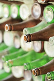 Play of light, reflection and transparency on a wall of bottles Royalty Free Stock Images
