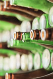 Play of light, reflection and transparency on a wall of bottles Stock Photography