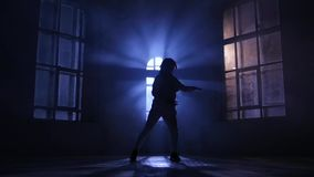 Play light and shadow, dance in moonlight. Silhouette, slow motion. Play light and shadow in girl dance in moonlight, performing and practicing contemporary stock footage