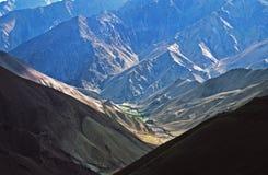Play of light and shadow on Himalayn valley and neighboring moun Stock Image