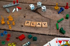 `Play` made from Scrabble game letters. Risk, Battleship pieces, Monopoly, Settler of Catan and other game pieces stock photo