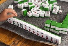 Play mahjong. Playing mahjong is China's traditional Stock Image