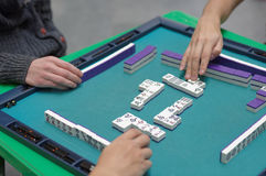Play Mahjong. St. Petersburg, Russia - October 20, 2016: People play Mahjong during the China Day in Pulkovo airport. The event is organized by the airport royalty free stock photo