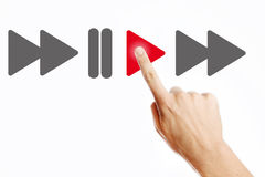 Play. Male hand pressing play button on the virtual screen Royalty Free Stock Image