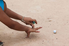 Play Marble. On sand floor stock photo