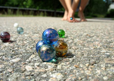 Play marbles 2. A pyramid of marbles with someone trying to hit it Royalty Free Stock Photography