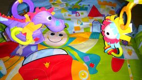 Play matt. Image of a play matt with toys hanging Stock Image