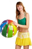 Play with me. Sportive girl with ball, isolated with clipping path included Stock Photos