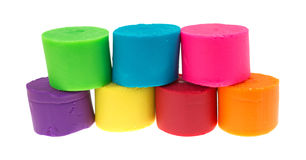 Play modeling putty stacked on a white background. Royalty Free Stock Images