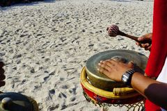 Play music at cultural festival at the beach. A cultural festival at the beach involve numbers of dancers, traditional music players and artists with music royalty free stock image