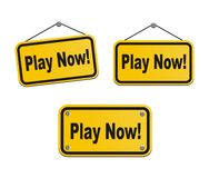 Play now - yellow signs Royalty Free Stock Photos