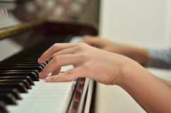 Play paino. Conservatory students are learning piano Royalty Free Stock Images
