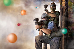 Play paintball game. Two player with guns Royalty Free Stock Photography
