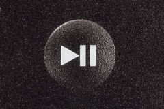 Play and Pause Button Macro. Play and pause remote control button extreme macro detail royalty free stock images