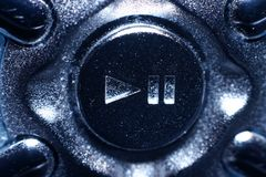 Play/pause button, metallic look Stock Images