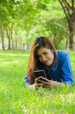 Play phone. Happy woman using a smart phone in the graden Stock Images