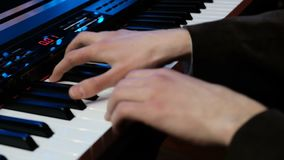 Play piano. Close up of man hands playing the piano in slow motion. Fingers on the piano. Look at a jazz pianist`s hands stock footage