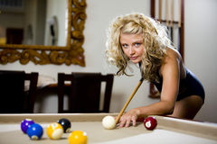 Play pool in a swimsuit Stock Image