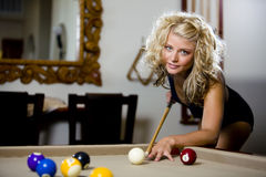 Play pool in a swimsuit pleasant Royalty Free Stock Image