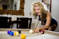 Play pool in a swimsuit smiling Stock Photos