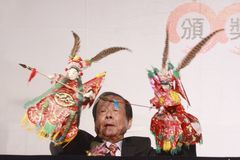Play puppet. The first Taipei traditional artist ceremony hold on Mar. 22 in Taipei. Zhong Renbi won the honor artist award and played puppet on the ceremony Royalty Free Stock Photography