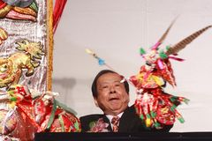 Play puppet. The first Taipei traditional artist ceremony hold on Mar. 22 in Taipei. Zhong Renbi won the honor artist award and played puppet on the ceremony Royalty Free Stock Image