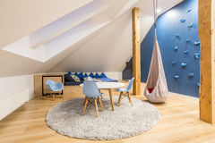 Play room at the attic. With blue wall royalty free stock photos