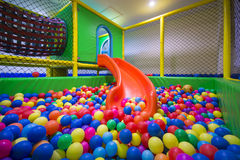 Play room with colorful balls at hotel Stock Images