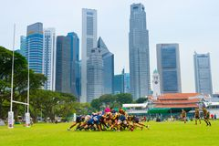Play rugby team  Singapore downtown Royalty Free Stock Photography