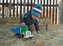 Play in sand box Stock Photo