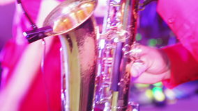 Play on saxophone. Men's fingers playing on saxophone stock video footage